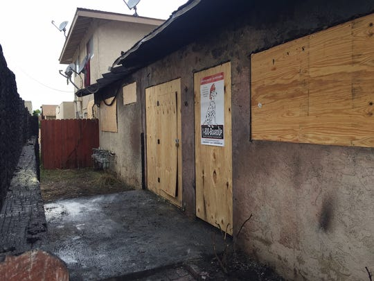 An apartment in 2000 block of North Ventura Road in Oxnard is boarded up Tuesday morning. A fire at the complex after midnight displaced 15 people.