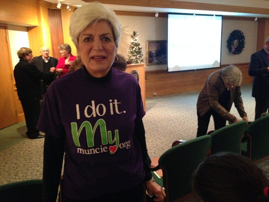 Roni Johnson wears a 'volunteer' shirt at the Muncie Action Plan's annual-report meeting at Minnetrista.