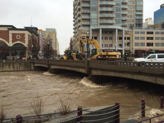 Floodwaters rise beneath the Sierra Street Bridge in