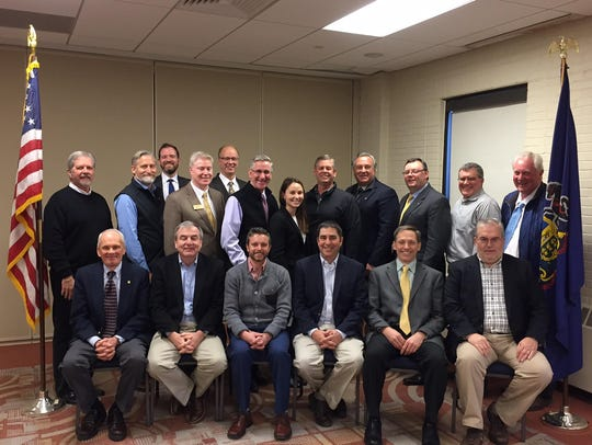 Scott Sechler (back row, far right),CEO and president