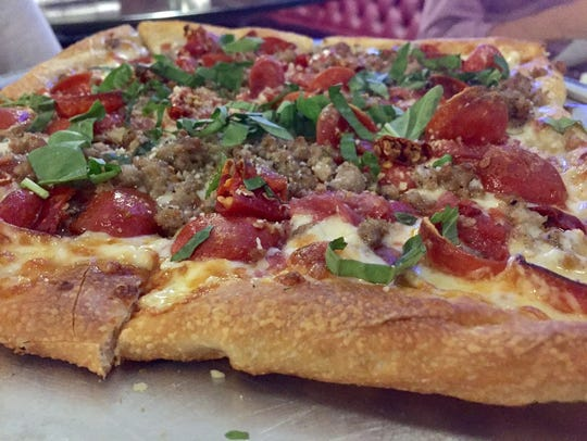 The Red Face Calabrese pizza was topped with pepperoni,