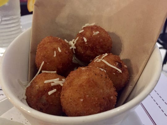 Centrale's rice balls are filled with creamy risotto.
