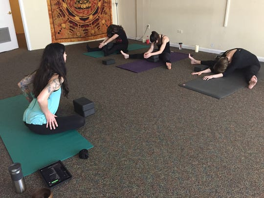 Yoga Instructor Megan Maybee led a small class Thursday afternoon at the Works of Light Yoga, a new yoga studio in downtown Tallahassee.
