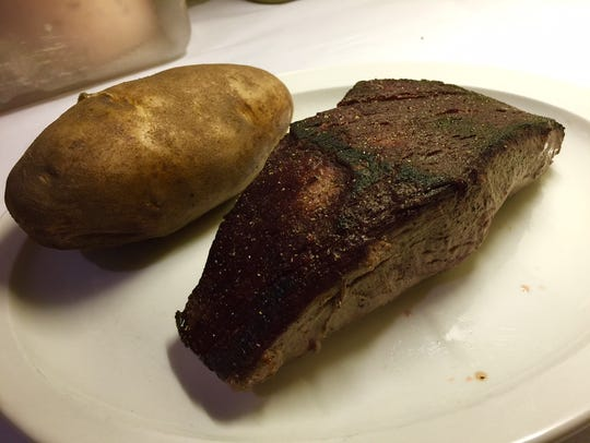 Filet mignon and baked potato.