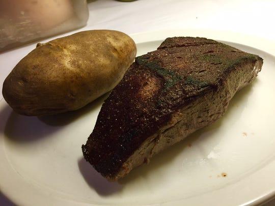 Filet mignon and baked potato.