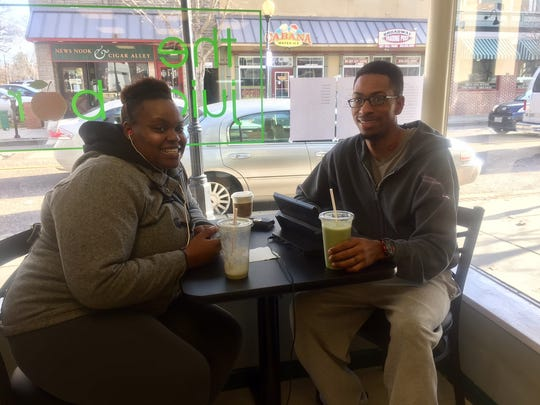 Customers Khalia Walters and Leon Walker enjoy smoothies at The Juice Bar in Merchantville.