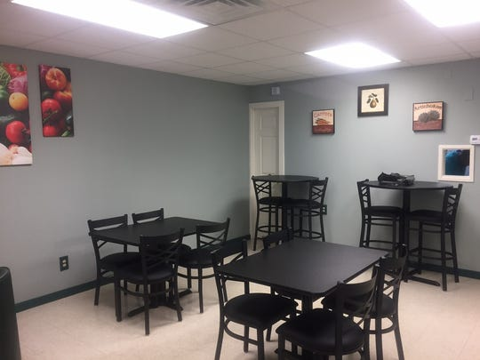 High top and cafe tables offer a cozy spot to enjoy juices and snacks at The Juice Bar in Merchantville.