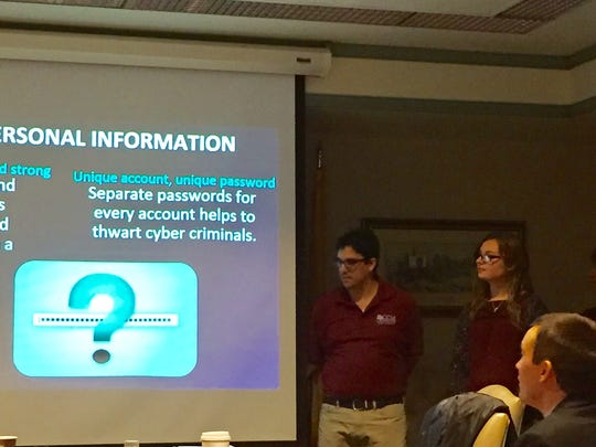 County College of Morris student Brian Seligson, president of the Cybersecurity Club, helps give a presentation to the Morris County freeholders on Jan. 25, 2017 on how to protect data on electronic devices.