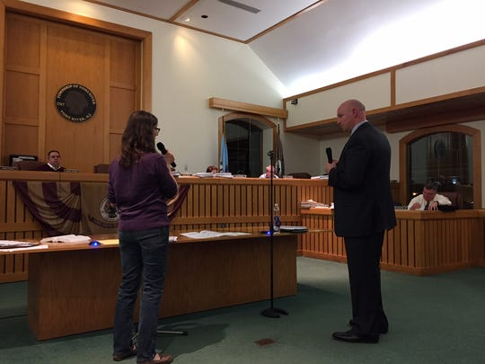 Oliver Street resident Penny Boehle (l) questions planner James Kyle at the Toms River Board of Adjustment meeting Thursday night.