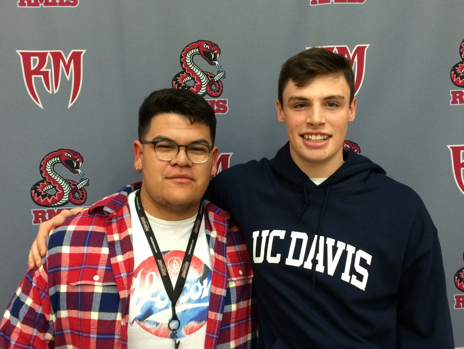 Jonny Avail (left) and Daniel Whelan, teammates on the Rancho Mirage football team, both signed their national letters of intent Wednesday to play college football next fall.