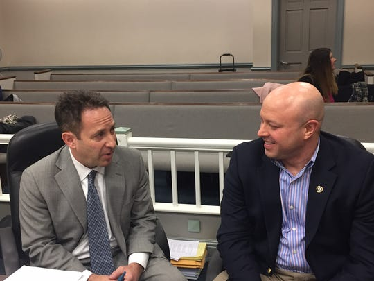 On left, attorney Eric Harrison, who defended Randolph Police Department against gender discrimination claims, in Superior Court, Morristown, in December 2016 with Police Chief David Stokoe.