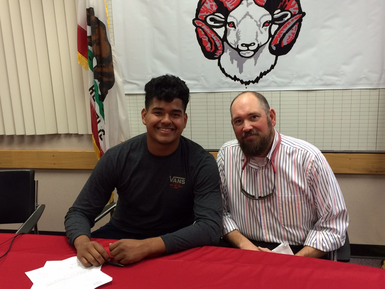 On Thursday, Desert Mirage senior Froilan Rodriguez, with coach Jeff Tebelak, signed his national letter of intent to play football next year at Western New Mexico.