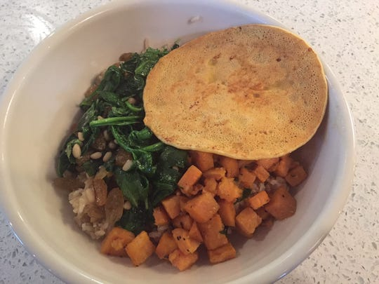The Green Bowl from The Green Dog Cafe in Columbia Tusculum has spinach, potatoes and a socca pancake