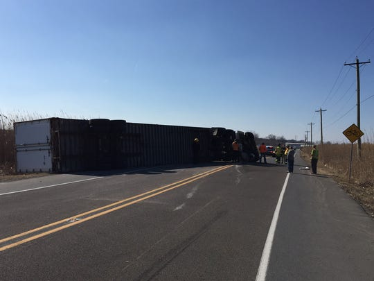 The truck blocked both lanes of Del. 9.