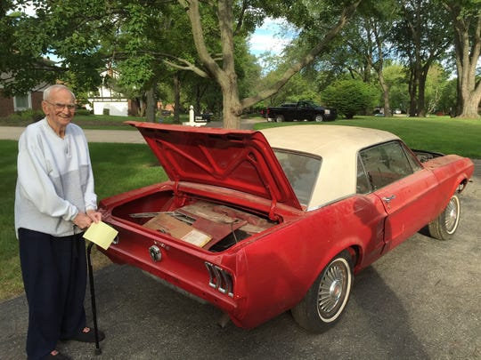 Harry Donovan with his 1967 Mustang before it was taken to The Finer Details Automotive Restoration in Danville in August for a makeover.