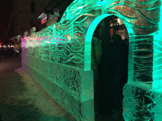 The ice bar outside St. Paul Fish Co. at the Milwaukee Public Market last year fairly glows. Weather permitting, it's back again this weekend.