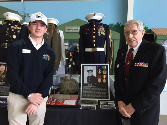 From left, Will Twomey and Korean War veteran Al de