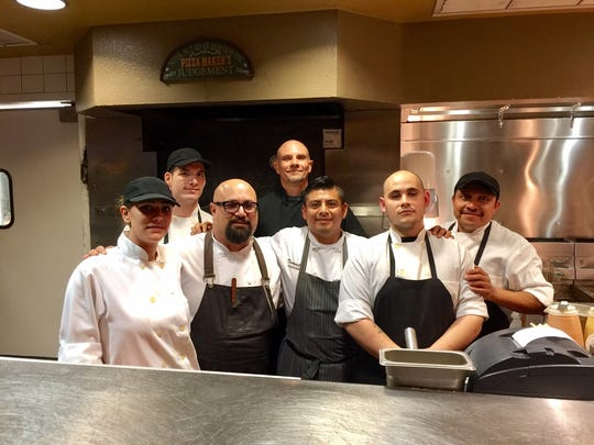 New chef Adam Ornellas (bottom, second from left) and his crew.
