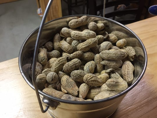 Buckets of peanuts sit atop the high tops of Eclipse Brewing Company in Merchantville. Guests can bring their own snacks or order from Park Place next door.