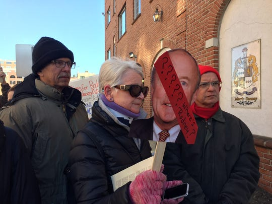 Woman holds a placard with U.S. Rep. Rodney Frelinghuysen's