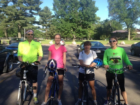 Wisconsin Rapids community members Gregg Hepp and Dotty Ho ride bikes with Kristie (Rauter) Egge and Michelle Goetsch from the Wood County Health Department.