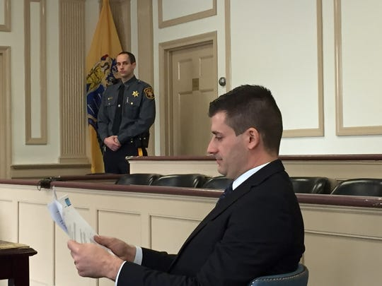 Morris County Assistant Prosecutor Matthew Troiano checks a report before jury selection on Feb. 21, 2017 for the trial of accused killer Virginia Vertetis.