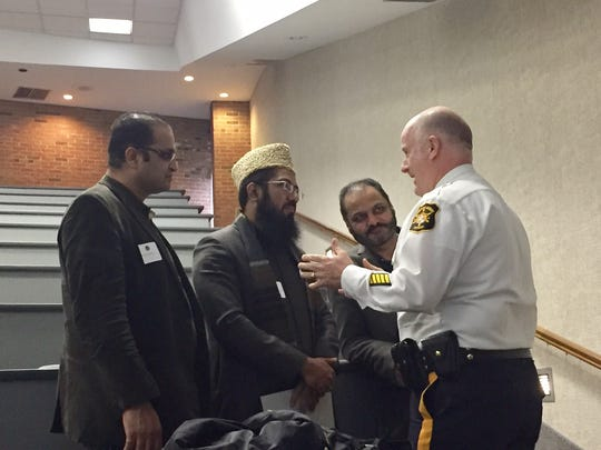 In white shirt, Morris County Sheriff James M. Gannon chats with clerics and educational leaders who attended a seminar Feb. 27, 2017 on security at churches and schools.
