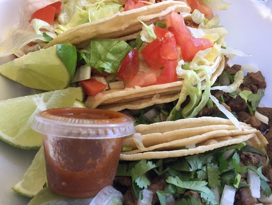 Street-style chicken and steak tacos ($2 each) are