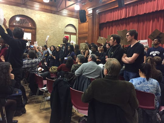 Students stood and turned their backs to Charles Murray as he began to speak at Middlebury College in Vermont on March 2, 2017.