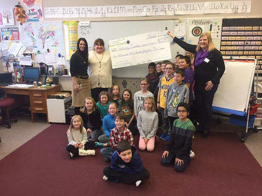 A third-grade class at Pewaukee Lake Elementary presents