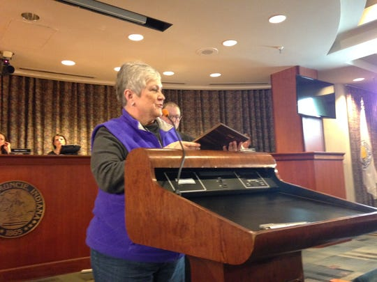 Retired teacher Kay Rankin accepts the Citizen of the