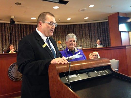 Muncie City Councilman Brad Polk presents the citizen of the month award to retired teacher Kay Rankin.