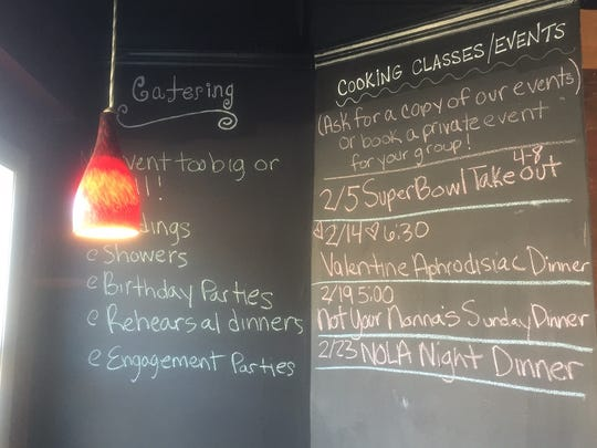 A blackboard announces cooking classes and catering options at Silver Spoon in Westmont.