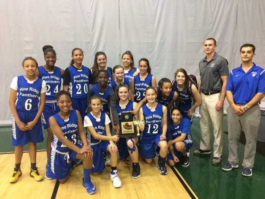 The Pine Ridge Middle School girls basketball team recently won the CCAC title, defeating Corkscrew Middle 30-22 in the championship game.