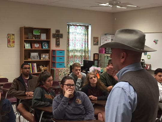 U.S. Rep. Clay Higgins speaks to students at Iota High School. Higgins wants to pursue legislation to create Tactical School Resource Officers in all of the country's public schools.