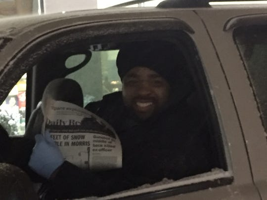 Chris Cook, a newspaper driver, drops off his load of newspapers at 7-11 in Morristown at 4 a.m. during the storm on March 14, 2017.