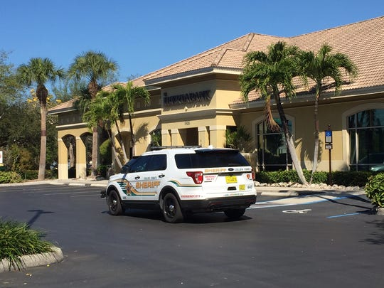 Collier County Sheriff's Office deputies investigated a bank robbery Wednesday, March 22, 2017, at Iberiabank on Pine Ridge Road in Naples.