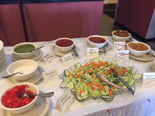 A variety of condiments is available at the lunchtime buffet at Taj Mahal, an Indian restaurant on Carpenter Station Road that opened in August.