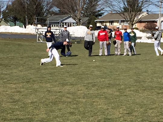 Elco senior Kyle Knight takes ground balls in the outfield during practice Thursday, March 23.