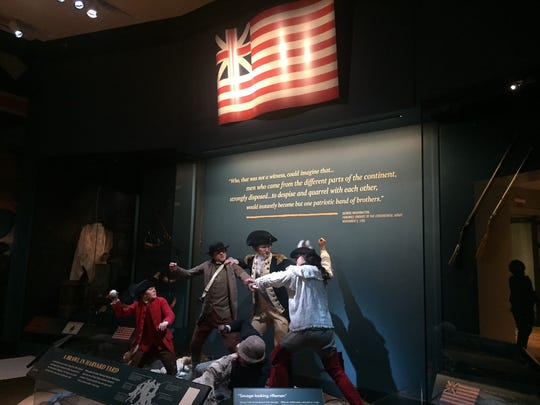 General George Washington breaks up a fight among his troops at Harvard in this installation at the Museum of the American Revolution in Philadelphia.