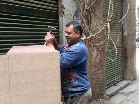 In a dusty alleyway just blocks from President Sisi's