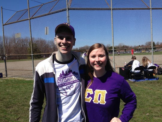 Wayne State's Sigma Pi chapter hosted the softball game at Inglenook Park. From left are Sigma Pi brother Jared Hoehing and fraternity sweetheart Devon Abbey, of Kappa Delta.