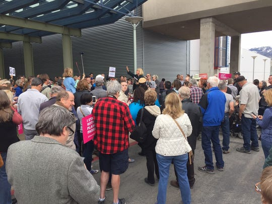 People gather Monday in Reno outside a full-to-the-brim town hall meeting featuring Sen. Dean Heller and U.S. Rep. Mark Amodei. Authorities turned away the overflow crowd after the hall filled up for the event.