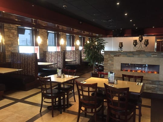 The interior of SweetWater Bar & Grill offers multiple
