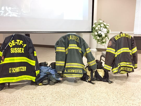 The fire coats of Alan Schweitzer are on display at his funeral in Laurel, Delaware, on April 26, 2017.