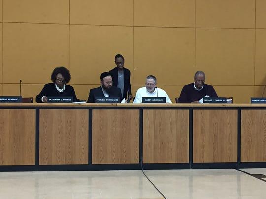 From left: East Ramapo Superintendent Deborah Wortham, School Board President Yehuda Weissmandl, board member Sabrina Charles-Pierre (standing), board member Harry Grossman and board member Bernard Charles prior to the April 26 special meeting.