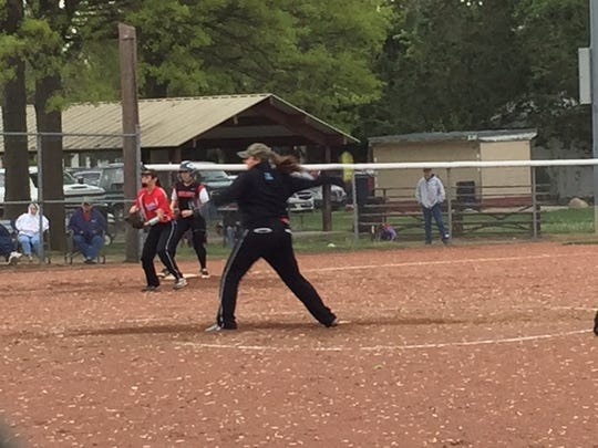 Ridgedale senior Hannah Ferguson delivers a pitch Monday evening in Sycamore.