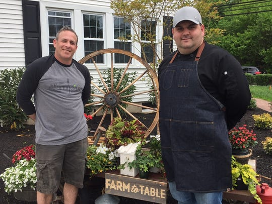 Chef David Murray (right) stands outside The Farmhouse restaurant in Cherry Hill last year with owner Stu Wanicur. Murray will reopen The Farmhouse, which closed this summer, as Denim American Bistro. Wanicur remains an owner of the property, which Murray is leasing.