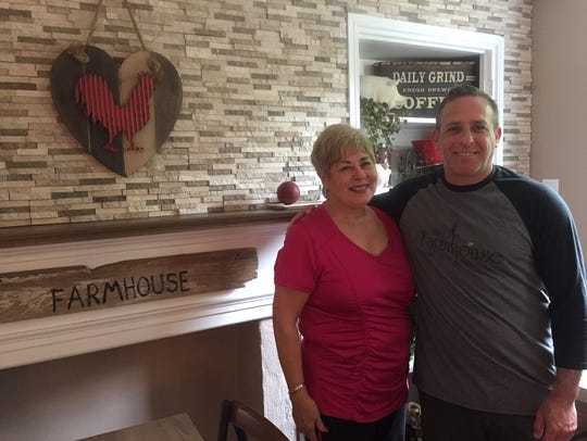 Stu Wanicur and his mother, Elaine Levy, gather near a fireplace at The Farmhouse in Cherry Hill last year before the restaurant opened in Cherry Hill. Wanicur has said he had a ton of support from family and friends to launch the restaurant.