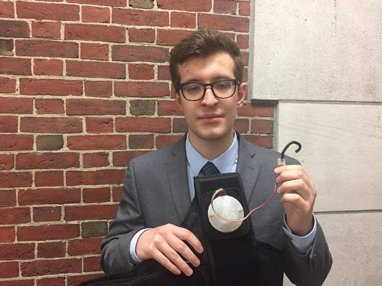 Justin Fraumeni with a device for monitoring first
